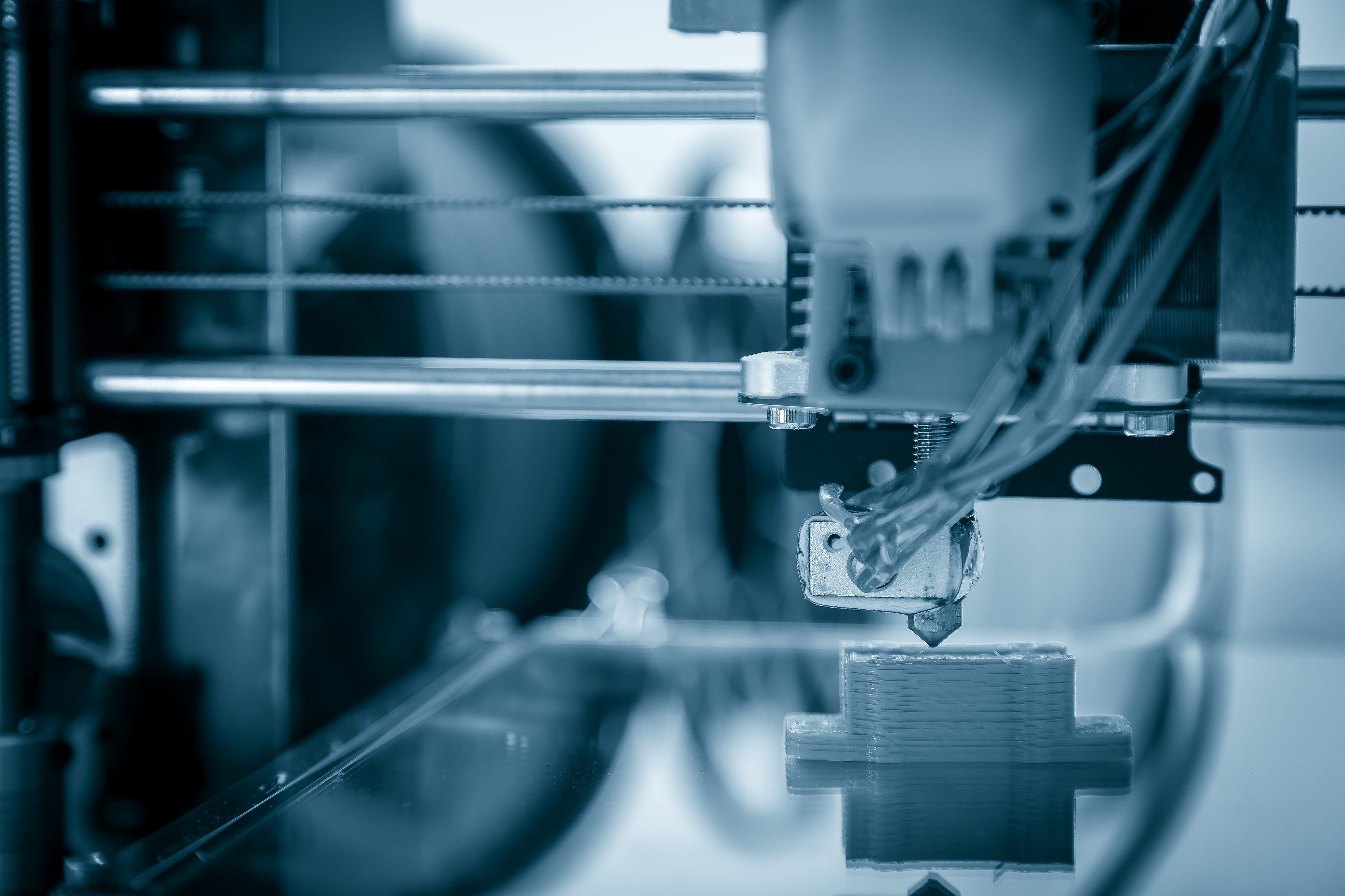 Electronic three dimensional plastic printer during work , 3D printer, 3D printing all contribute to additive technologies